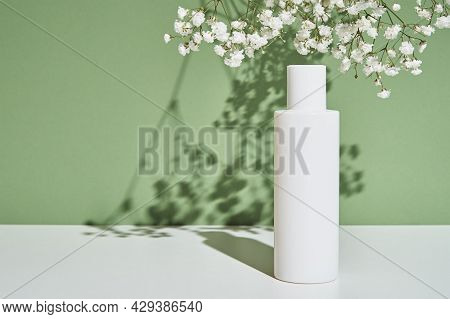 Beauty Cosmetic Product In White Bottle On Green Background. Natural Organic Cosmetics