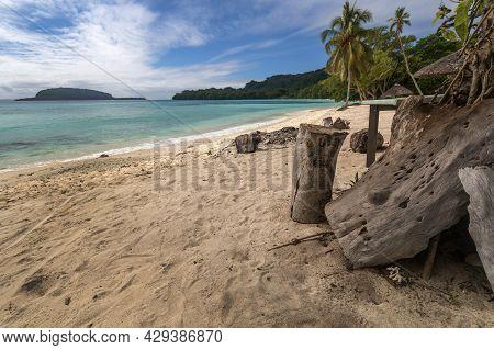 A Sandy Beach Next To A Body Of Water On Santo Island In Vanuatu