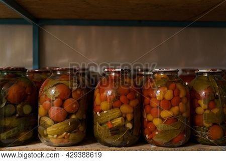 Shelves With Marinated Veggies In Glass Jares. Fermented Organic Food.