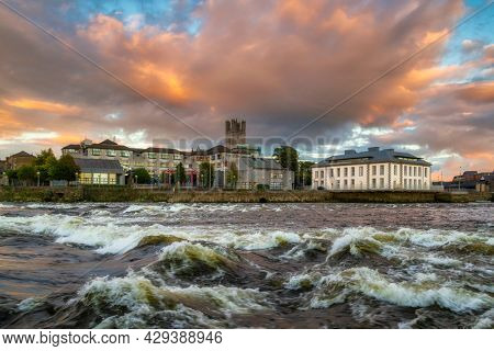 Architecture of Limerick city and Shannon river at sunset, Ireland