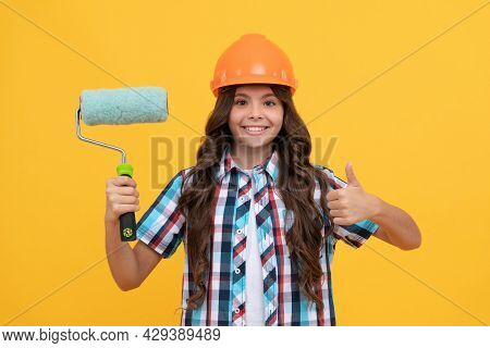 Child In Helmet. Roller Brush For Decoration. Kid Education. Renovation Work.