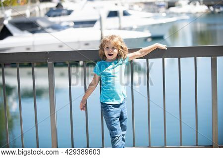 Vacation Time. Happy Kid Stand At Quay Railing. Summer Vacation. Summertime. Vacay Mode