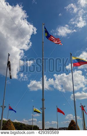 The National Flag Of Malaysia, Surrounded From The Flags Of The Malaysian States.  Captured At The P