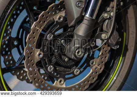 Close Up To The Disc Break Of A Motorcycle. The Break System Of A Strong Fast Super Bike. Macro Phot
