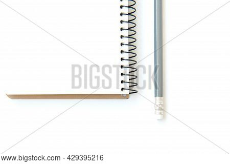 Open White Notepad On Spring And Pencil Isolated On White Background With Copy Space. Business Agend
