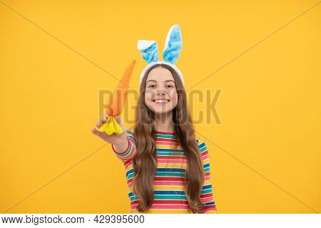 You Should Try This. Just Having Fun. Happy Childhood. Cheerful Bunny Kid With Carrot.