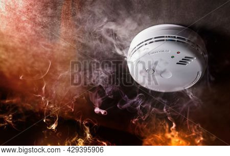 Smoke detector and fire alarm in action background with copy space