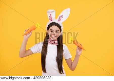 Happy Easter Teen Girl In Bunny Ears And Bow Tie Hold Carrot, Easter