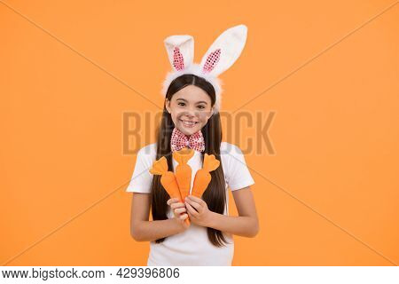 Ready To Celebrate. Time For Fun. Adorable Kid Looking Funny With Carrot. Paschal Spring Holiday.