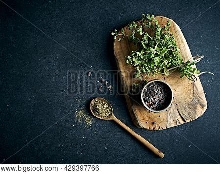 Fresh Marjoram, Black Salt and ground Black Pepper. From top. Copy space