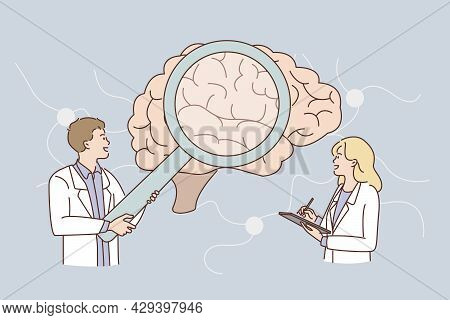 Research Of Human Brain Concept. Young Man And Woman Doctors Scientists Standing Looking At Huge Hum