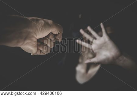 Domestic Violence Concept,scared Woman Protecting From Men Aggression.  Stop Violence Against Women,
