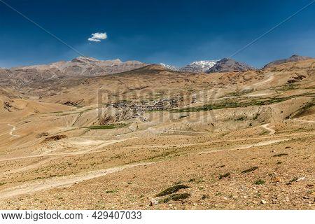 Kibber village and road in Himalayas. Spiti Valley, Himachal Pradesh, India