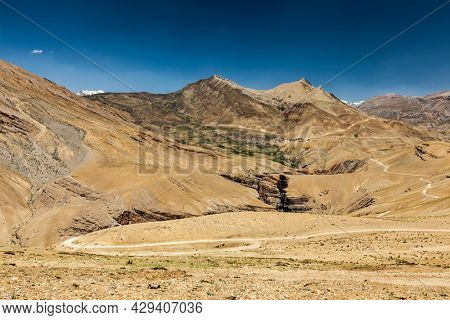 View of Spiti valley in Himalayas with Kibber village and road. Spiti valley, Himachal Pradesh, India