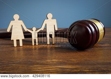 Family Law And Adoption Concept. Figures And Gavel.