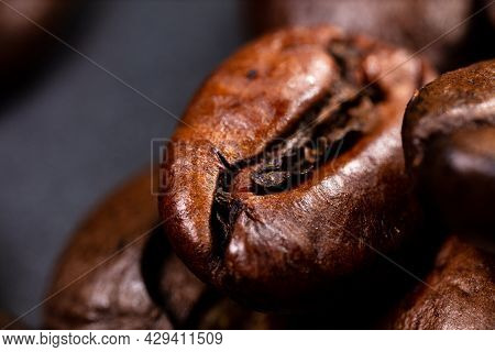 Close Up Of A Coffee Bean. Macro Panorama Photography Of Coffee Beans In High Resolution. Detailed U