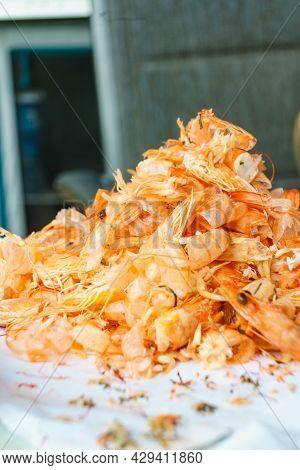 Seafood, Ocean Food. Pile Of Shrimps Heads And Shells. Peeling Raw Fresh Shrimp.