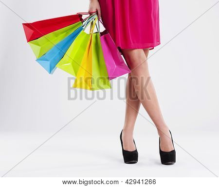 Low section of a woman with full of shopping bags