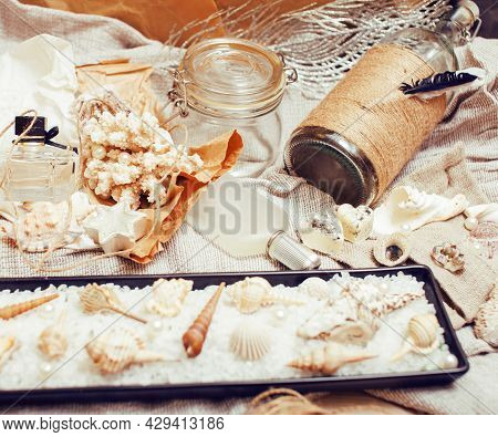 A Lot Of Sea Theme In Mess Like Shells, Candles, Perfume, Girl Stuff On Linen, Pretty Textured Post