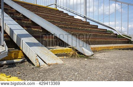 The Staircase Of The Pedestrian Crossing With Traces Of Destruction. Two Wheelchair Rails. Metal Rai