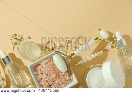 Skin Care Beauty Concept With Face Roller On Beige Background