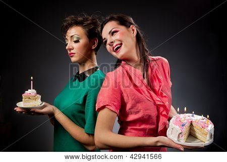 Two glamour girls with cake.