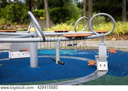 An Abandoned Carousel In A Playground. Playgrounds Are Blocked For Use In The Corona Lock Downs. Cov