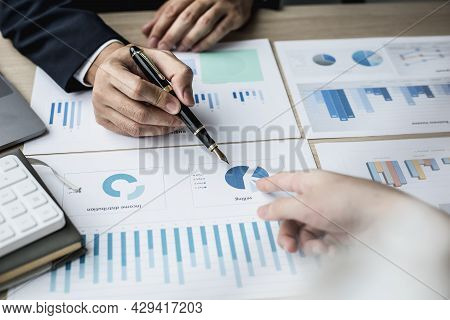Two Businessmen Pointing At A Chart On The Document, They Are Startup Friends Together, Business Par