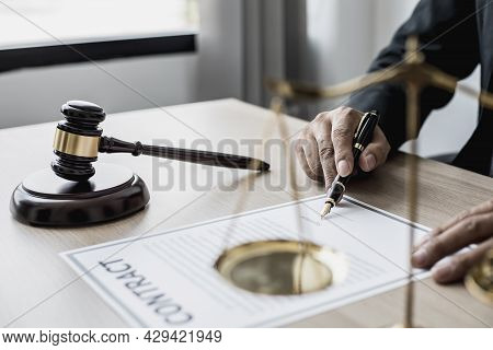 A Small Court Judge's Hammer Is Placed On The Lawyer's Table, The Lawyer Is Advising The Client To H