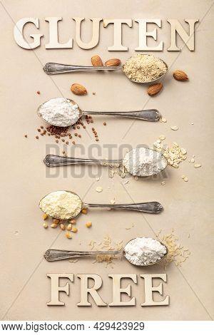 Metal Spoons Of Various Gluten Free Flour Almond Flour, Oatmeal Flour, Buckwheat Flour, Rice Flour,