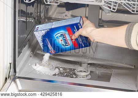 Estonia, Tallinn, 21.01.2021 Adding Salt To Dishwasher. Finish Dishwasher Salt Adding To Avoid Scale