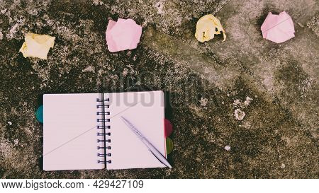 Notebook Pen And Crumpled Paper On Rustic Floor. Mistake Learning, Wrong, Blooper, Error, Regret Say