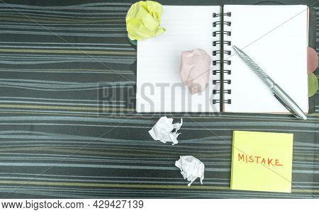 Mistake Written On Sticky Notes. Learning, Wrong, Blooper, Error, Regret Sayings Background. Fault,