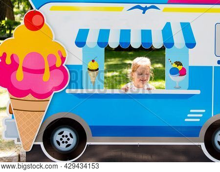 Child Pretends To Sell Ice Cream From An Ice Cream Van