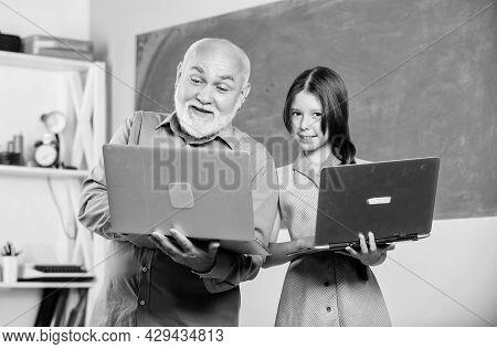 Back To School. Online Lesson. Teacher Of Digital Science. Teacher Help School Girl. Little Girl Wit
