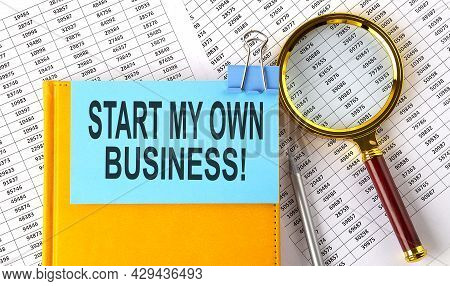 Start My Own Business Text On Sticker On Notebook With Magnifier And Chart. Business
