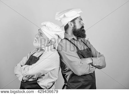 Mature Bearded Men Professional Restaurant Cooks Competitors. Culinary Industry. Chef Men Wear Apron