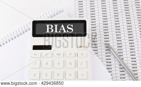 Bias Concept On Calculator On The Chart Background
