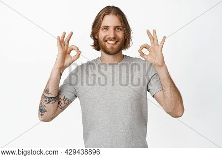 Image Of Handsome Blond Bearded Guy, Man Showing Ok Okay Sign In Approval, Nod To Praise, Compliment