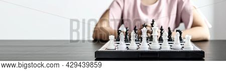 A Chess Board Game With White And Black Chess Pieces, Business Planning And Risk Management Concepts