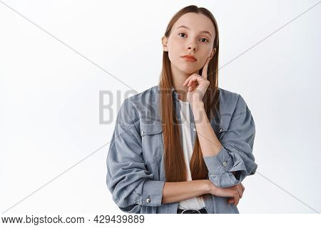 Thoughtful Young Woman With Long Hair Making Decision, Looking Serious While Thinking, Consider Opti
