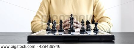 Black Chess Images Laid Out On A Chessboard, Concept Comparing Playing Chessboard With Business Admi