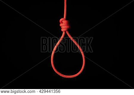 Red Braided Hanging Noose Tied Knot. Hanging Suicide, Death Penalty Concept. Red Hangman Knot, Black