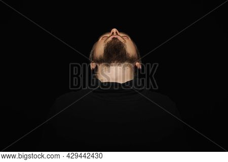 Cute Bearded Man, Threw Head Back, Black Background. Young Guy In Black Polo Neck Sweater. Confident