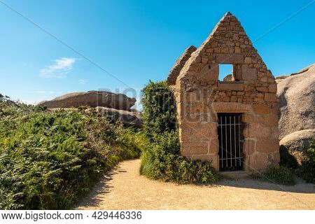 Stone Dwelling Along Lighthouse Mean Ruz, Port Of Ploumanach, In The Town Of Perros-guirec In The Co