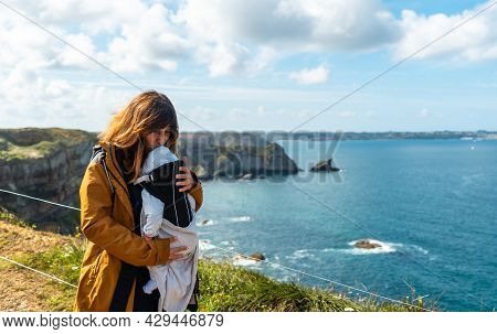 A Young Woman With Her Baby On The Coast Next To The Fort Des Capucins A Rocky, Cliff-side Islet In