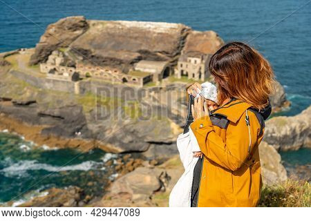 A Young Mother With Her Baby Looking At The Fort Des Capucins A Rocky, Clifftop Islet In The Town Of