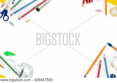 Back To School. Frame Of School Supplies ( Pencil, Scissors, Sharpener, Clips, Crayons ) On A White