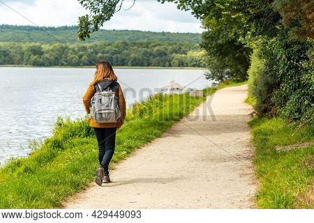 As A Youngster On The Lake Of Paimpont Trail In The Broceliande Forest, Ille-et-vilaine Department,