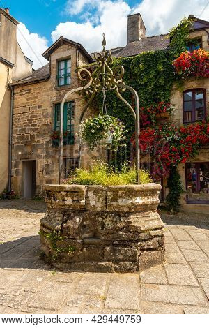 Water Well In The Square Of The Medieval Village Of Rochefort-en-terre, Morbihan Department In The B